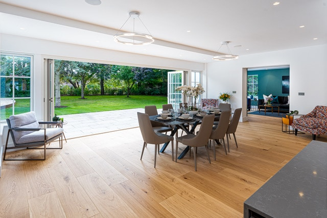 Dining area with the bi-fold doors open to the garden - Springfield House